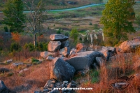 Veterans look toward the Devil's Den from Little Round Top (alternate)