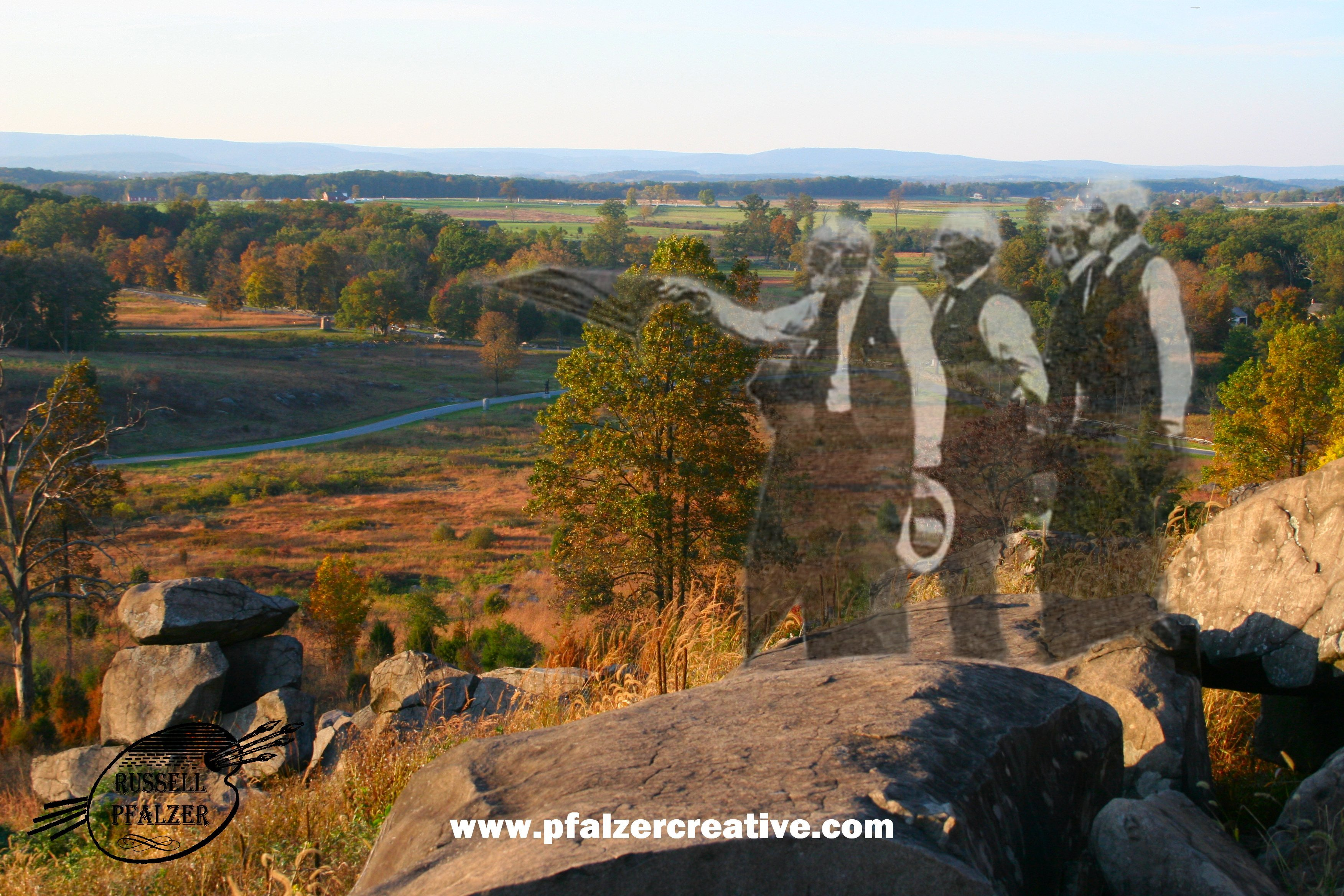 Veterans look toward the Devil's Den from Little Round Top